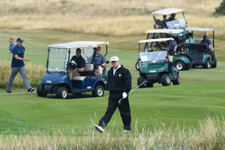 President Donald Trump walks as he plays a round of golf on the Ailsa course at Trump Turnberry, the luxury golf resort southwest of Glasgow, Scotland on July 14, 2018.