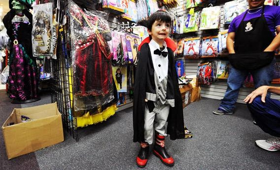 Four-year-old Rodney Lynch tries a 'dracula' outfit at a store.