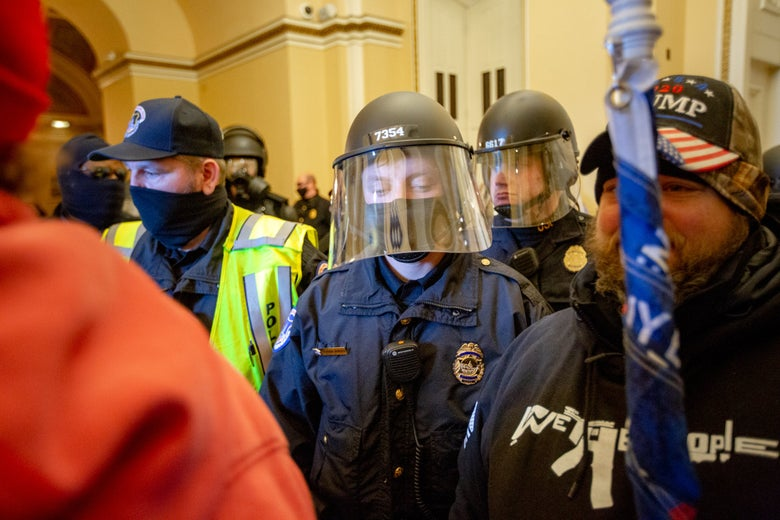 Police and rioters intermingled in the Capitol.