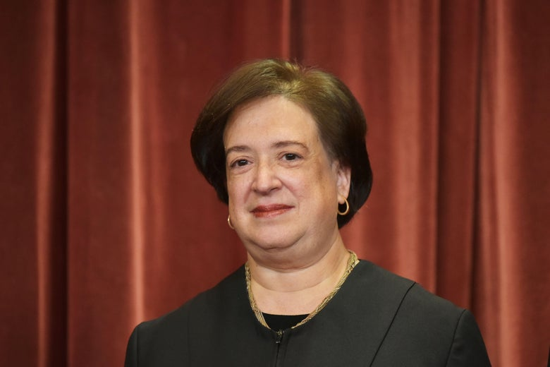 Justice Elena Kagan poses in the official group photo at the Supreme Court building.