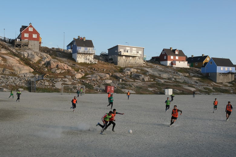 Locals play soccer on a Saturday on August 3, 2019 in Ilulissat, Greenland.
