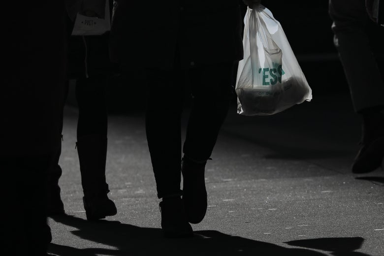A person carries a plastic bag during the lunch hour in Lower Manhattan, January 15, 2019 in New York City.