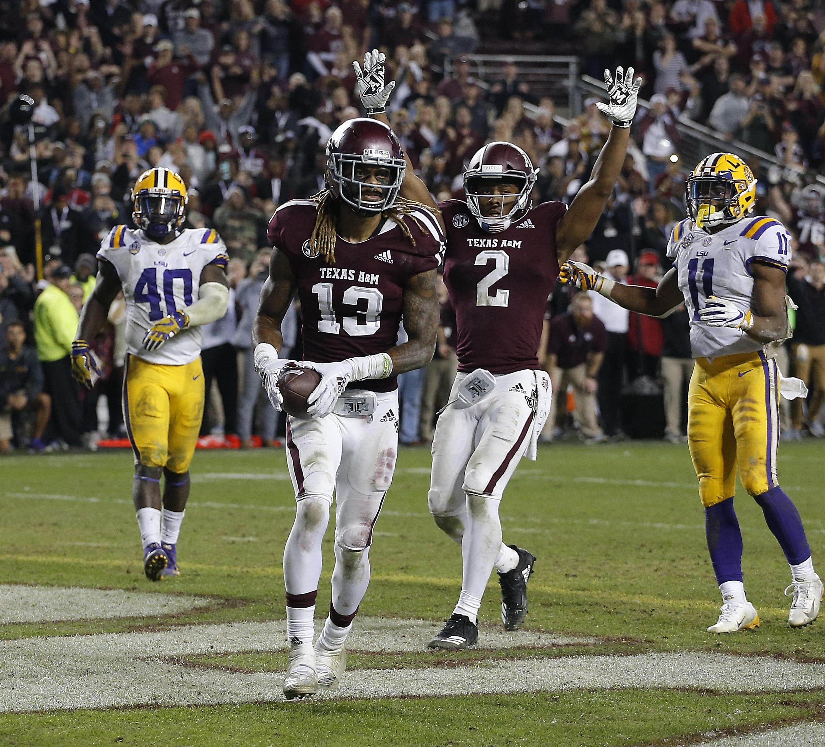 Kendrick Rogers #13 of the Texas A&M Aggies scores the winning two-point conversion.