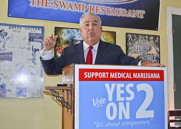 "John Morgan speaks at a news conference during his ""Yes on 2"" campaign in favor of a proposed state constitutional amendment to allow medical marijuana, in Gainesville, Florida, on Sept. 26, 2014"