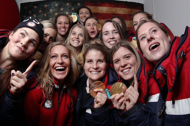 GANGNEUNG, SOUTH KOREA - United States snowboard gold medalist Jamie Anderson poses for a selfie with some members of the United States women's hockey team and their gold medals on the Today Show Set on February 22, 2018 in Gangneung, South Korea.