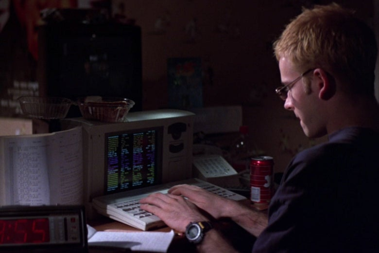 Screengrab from Hackers of someone writing code on a computer.