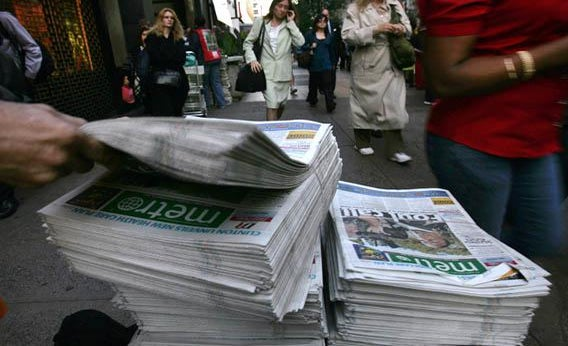 A newspaper stack outside the Long Island Railroad in New York, Sept. 18, 2007.