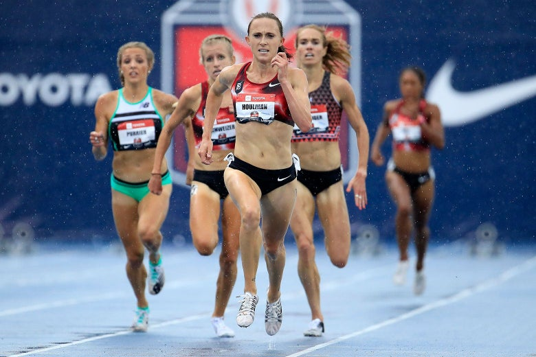 Shelby Houlihan ahead of four other runners on a blue track