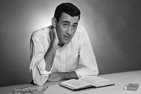 "Author J.D. Salinger poses for a portrait as he reads from his classic American novel ""The Catcher in the Rye""."