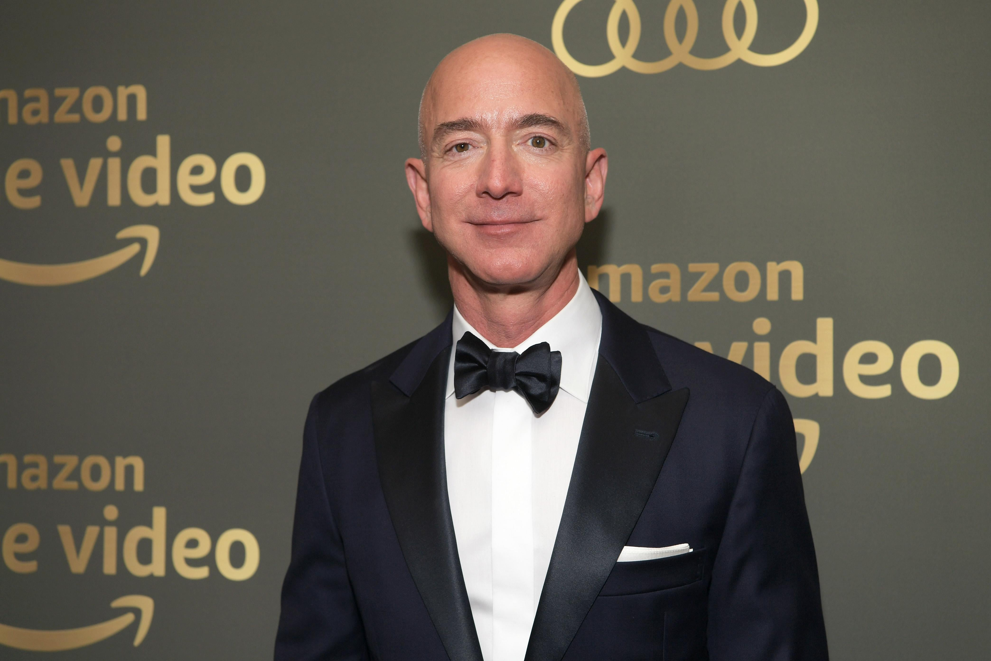 Jeff Bezos in a tux in front of an Amazon Prime Video backdrop.