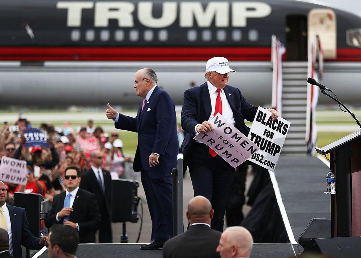 Republican presidential candidate Donald Trump and former New York City mayor Rudy Giuliani campaign together during a rally at the Lakeland Linder Regional Airport on October 12, 2016 in Lakeland, Florida.