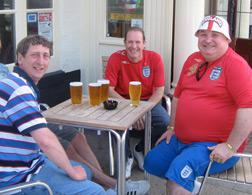 England supporters get ready for the Slovenia match at the Shrewsbury Hotel, a  pub in the town center.