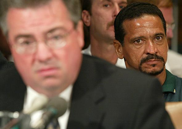 Juan Melendez (right), a former death row inmate who was exonerated, listens to testimony during a hearing before the Senate Judiciary Subcommittee on the Constitution on June 12, 2002, in Washington, D.C.