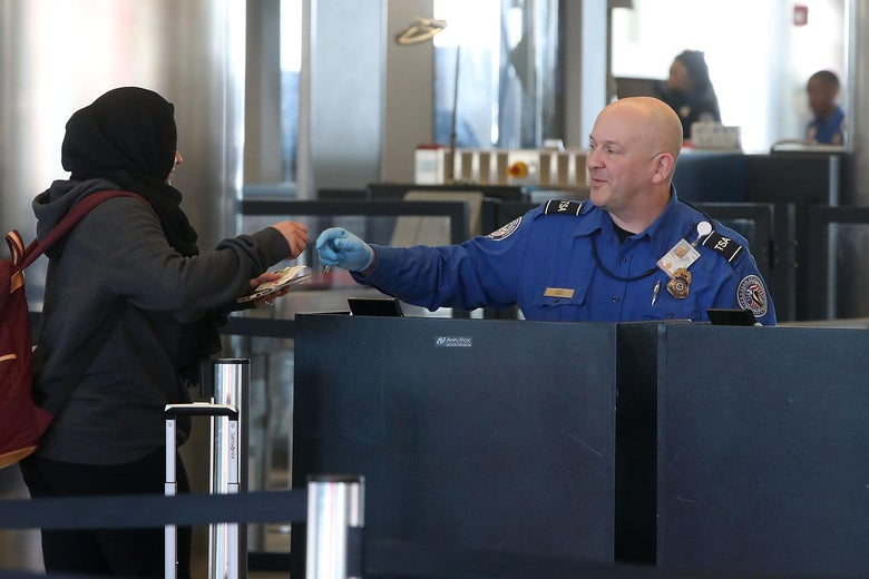 TSA employees, who are currently working without pay, screen passengers during the partial shutdown of the U.S. government, at Baltimore Washington International Thurgood Marshall Airport, on January 14, 2019 in Baltimore, Maryland.