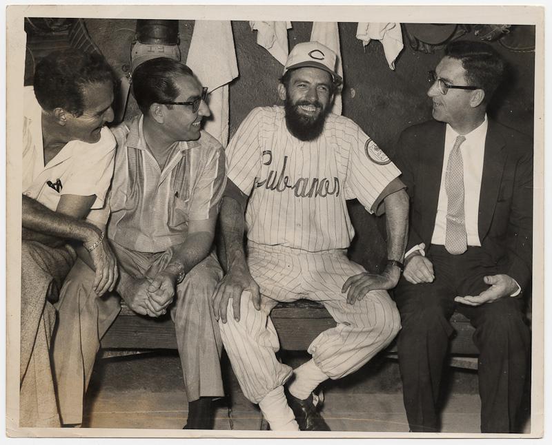 Camilo Cienfuegos, Cuban Guerilla Commander, wearing a Cubanos b,Camilo Cienfuegos, Cuban Guerilla Commander, wearing a Cubanos baseball uniform, 1959.