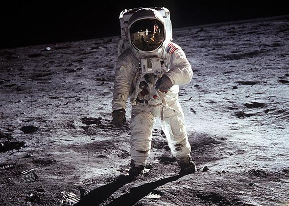 "Astronaut Buzz Aldrin, lunar module pilot, walks on the surface of the Moon near the leg of the Lunar Module (LM) ""Eagle"" during the Apollo 11 extravehicular activity (EVA). Astronaut Neil A. Armstrong, commander, took this photograph."