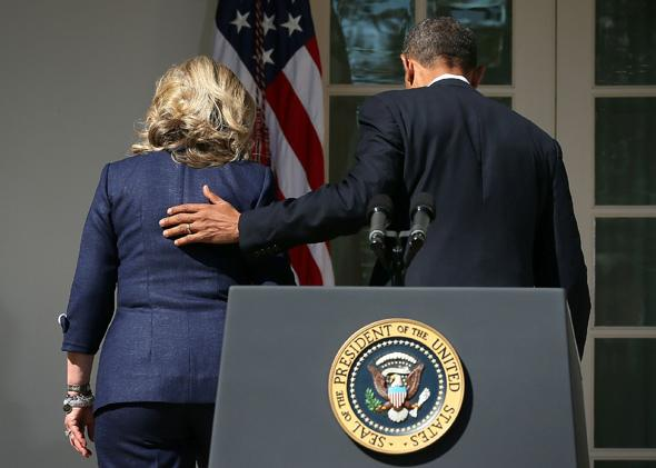 President Barack Obama and Hillary Clinton, then secretary of state, leave the Rose Garden after a statement at the White House in September 2012