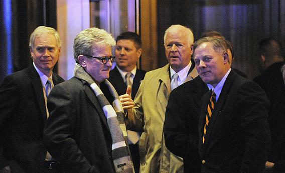 U.S. Sen. Ron Johnson (R-WI) , U.S. Sen. Tom Coburn (R-OK), U.S. Sen. Richard Burr (R-NC) and U.S. Sen. Saxby Chambliss (R-GA) leave the Jefferson Hotel after a dinner with President Barack Obama March 6, 2013 in Washington, DC. Obama called togeher the dinner meeting with several Senate Republicans in an effort to open the lines of communication between the White House and GOP.