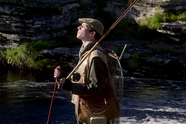 A still from The Crown in which Josh O'Connor as Prince Charles fishing, very incompetently.
