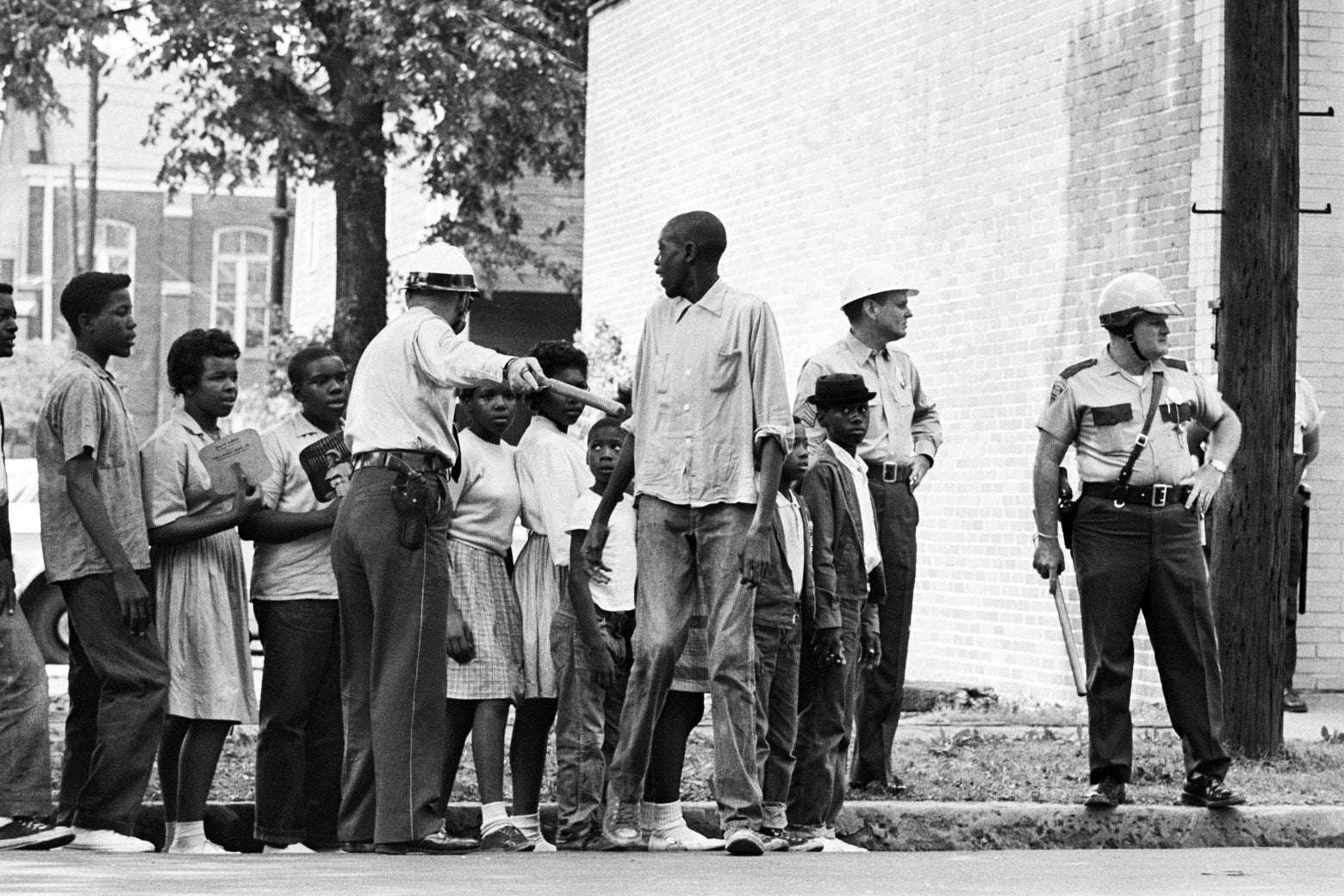 Children participating in a civil rights protest wait for a police van to take them to jail in Birmingham, Alabama, in 1963.