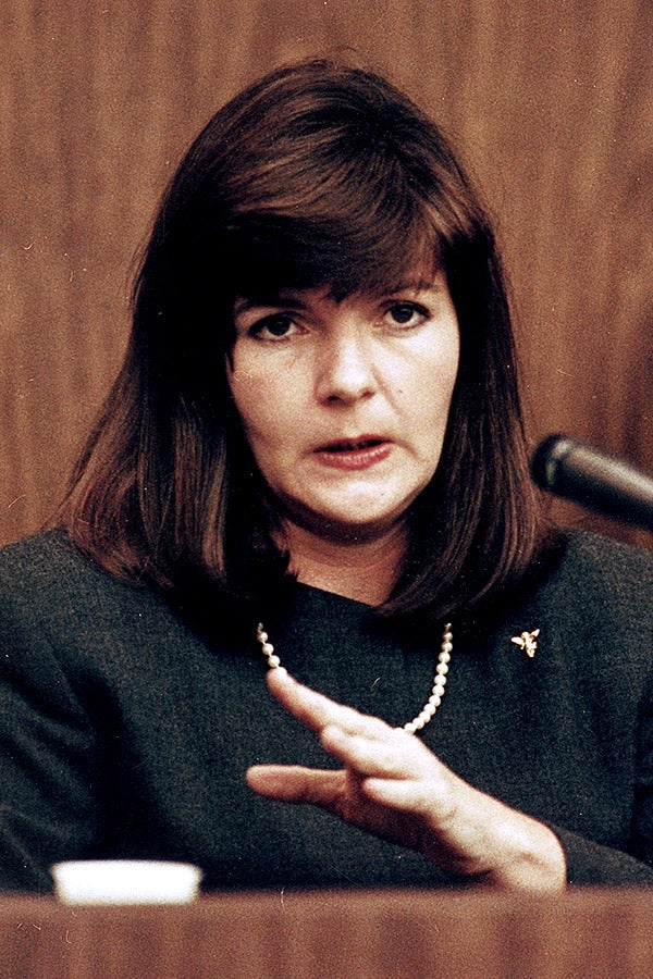 Patricia Bowman gestures while speaking into a microphone on the witness stand.