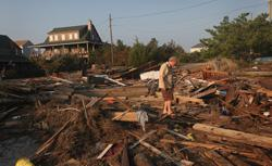 Billy Stinson's cottage built in 1903 in Nags Head, N.C., was destroyed by Hurricane Irene. Click image to expand.