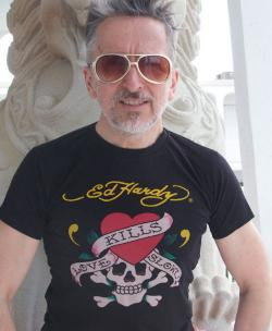 Simon Doonan in an Ed Hardy Love Kills tattoo t-shirt.