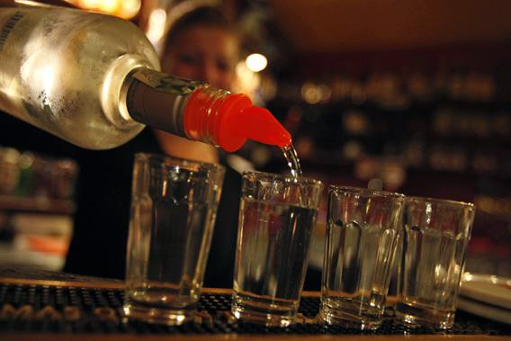 A bartender serves alcohol at a bar in Prague September 12, 2012.