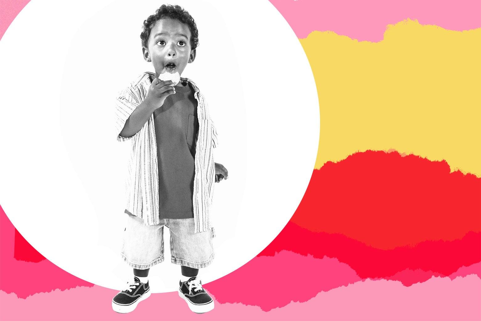 Cute little boy eating a cookie.