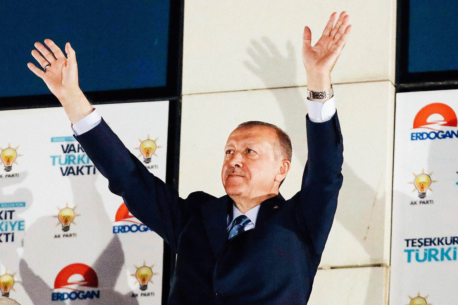 Arms outstretched in a double wave, Turkish President Recep Tayyip Erdogan greets his supporters gathered in front of the AKP headquarters in Ankara on Monday.