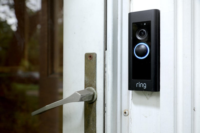 A Ring doorbell affixed to a home entrance.