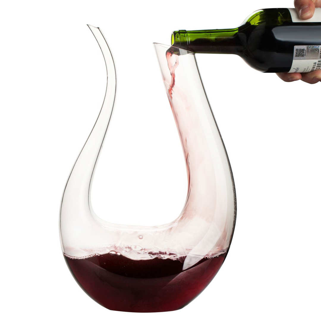 Wine being poured into the U-shaped carafe.