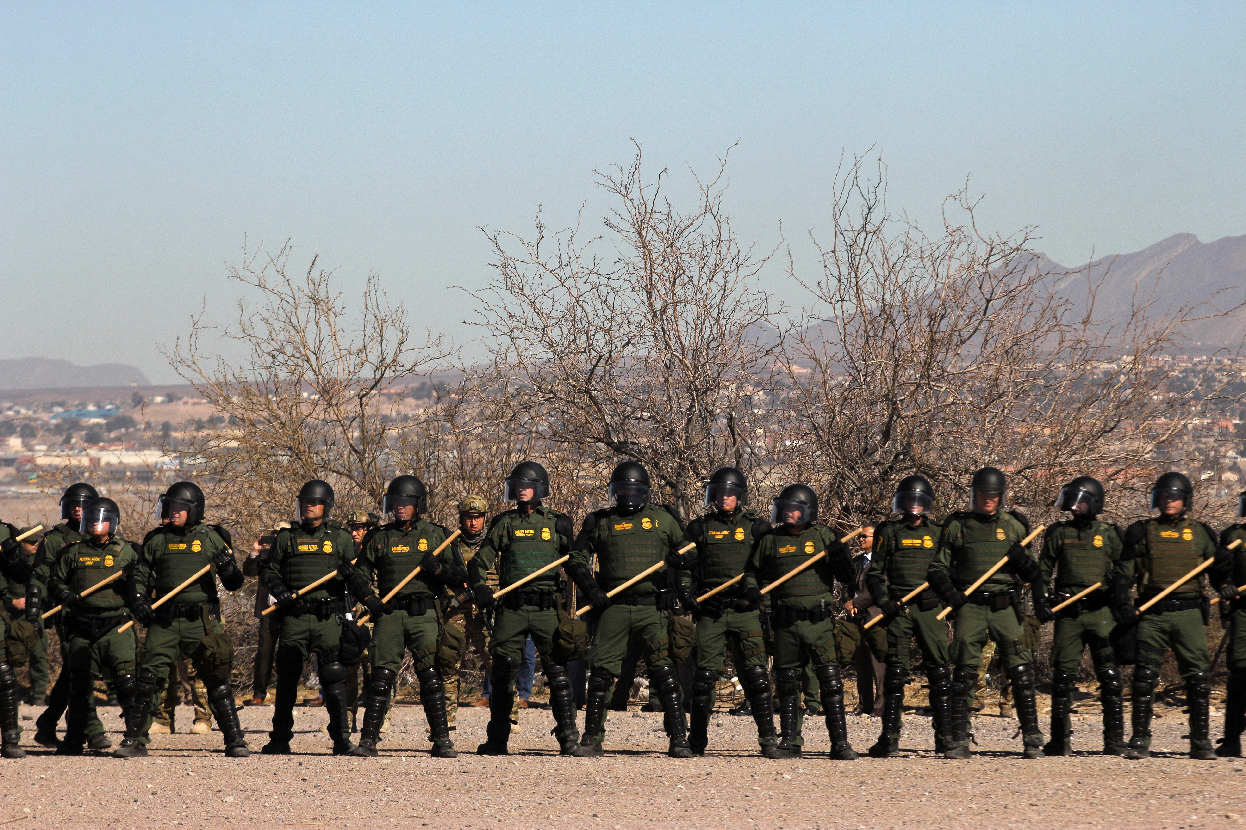 U.S. Border Patrol, Immigration and Customs Enforcement (ICE) and Customs and Border Protection (CBP) agents take part in a safety drill in New Mexico on Jan. 31, 2019.