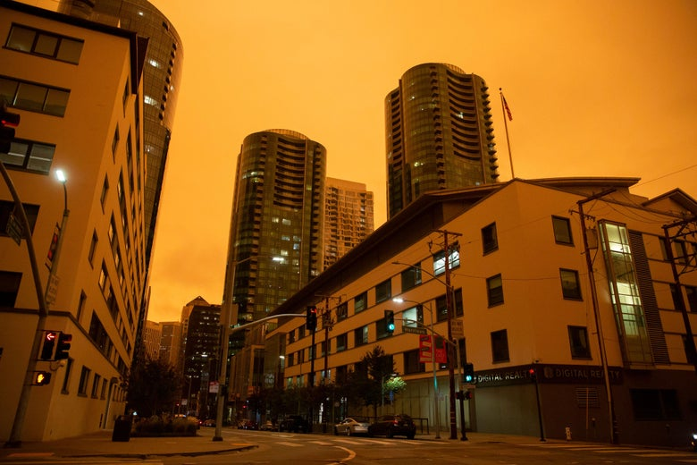 The Infinity Towers are seen under an orange smoke-filled sky.