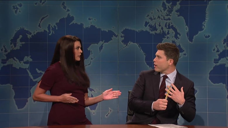 Watch Cecily Strong try to steal Colin Jost's microphone in SNL's take on the Jim Acosta affair.