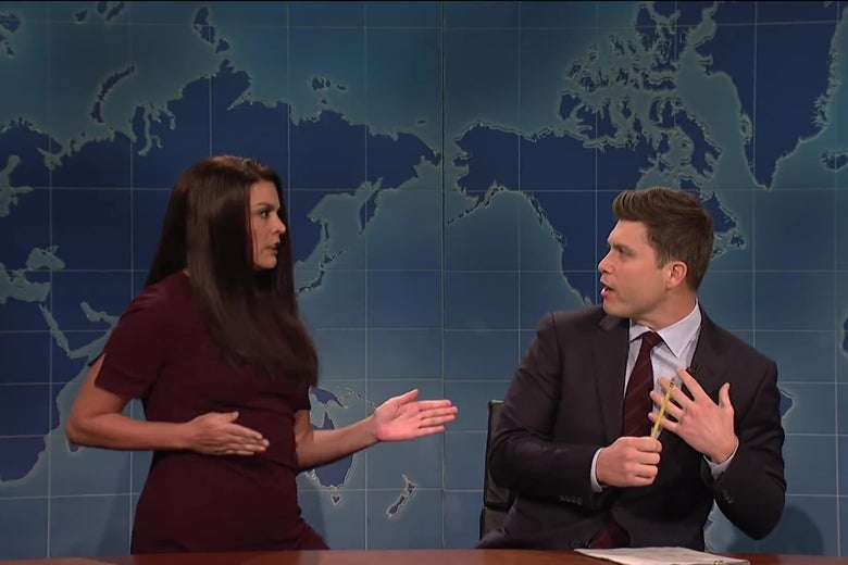Cecily Strong strikes a karate pose as Colin Jost recoils in terror.