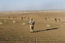 US Marines of 2nd Battalion 2 Marines of 2nd Marine Expeditionary Brigade walk back to their base in Afghanistan. Click image to expand.
