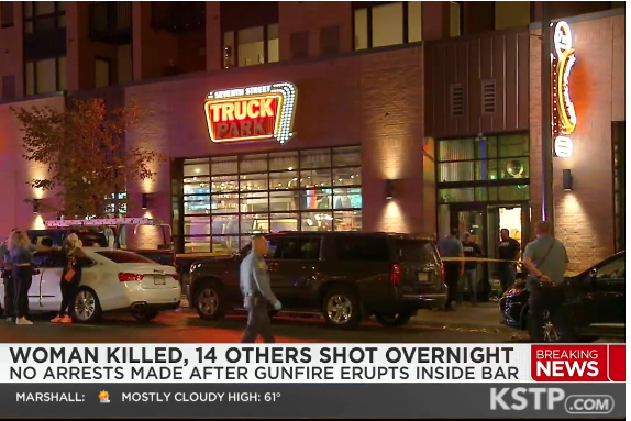 A screenshot from a local news report shows the scene outside the bar Truck Park in St. Paul, Minn. after the shooting that took place shortly after midnight on Oct. 10, 2021.