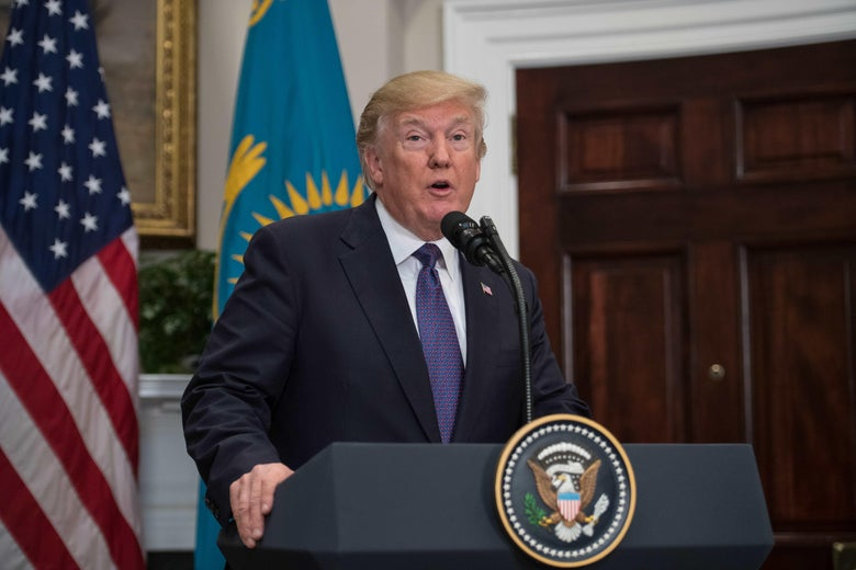 US President Donald Trump speaks to the press standing next to a door     (Photo credit should read NICHOLAS KAMM/AFP/Getty Images)