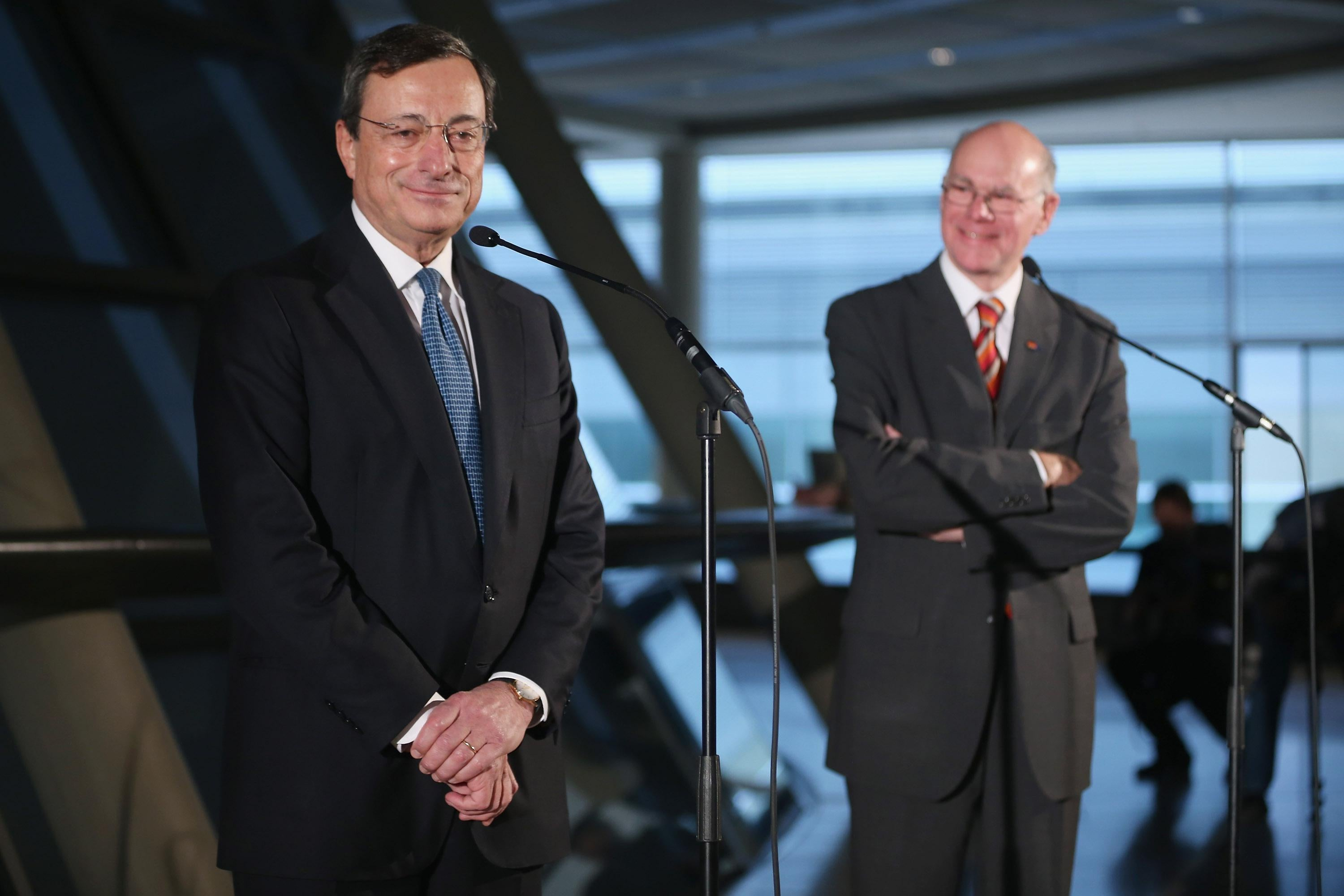 Mario Draghi, president of the European Central Bank, and Bundestag President Norbert Lammert speak to the media at the Bundestag after Draghi spoke to German parliamentarians on Oct. 24, 2012, in Berlin.