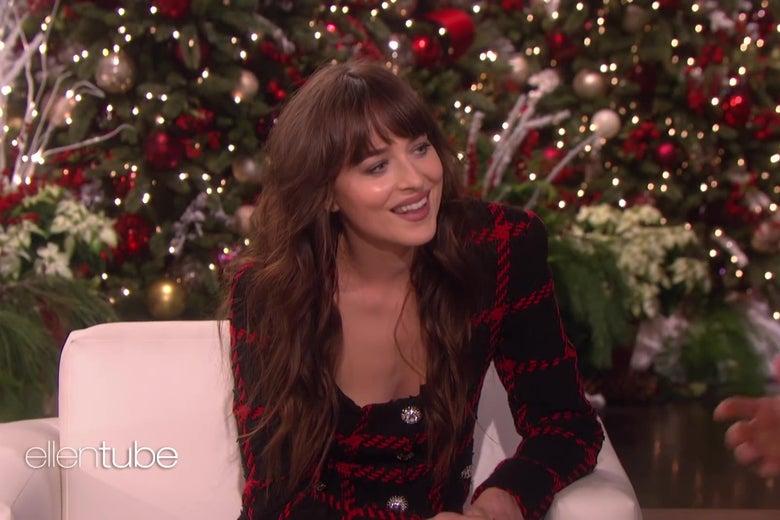 Dakota Johnson on Ellen's show, smiling as if to express polite disbelief.