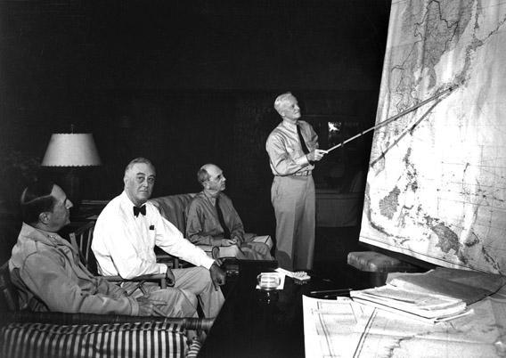 FDR in conference with Gen. D. MacArthur, Adm. Chester Nimitz, Adm. W. D. Leahy, while on tour in the Hawaiian Islands in January 1944.