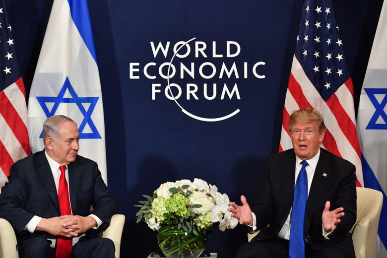 U.S. President Donald Trump (R) speaks with Israel's Prime Minister Benjamin Netanyahu during a bilateral meeting on the sidelines of the World Economic Forum (WEF) annual meeting in Davos, eastern Switzerland, on January 25, 2018. / AFP PHOTO / Nicholas Kamm        (Photo credit should read NICHOLAS KAMM/AFP/Getty Images)
