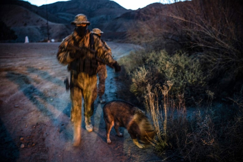 Members of the Constitutional Patriots New Mexico Border Ops Team militia, Viper and Stinger who go by aliases to protect their identity, patrol the US-Mexico border in Sunland Park, New Mexico on March 20, 2019.