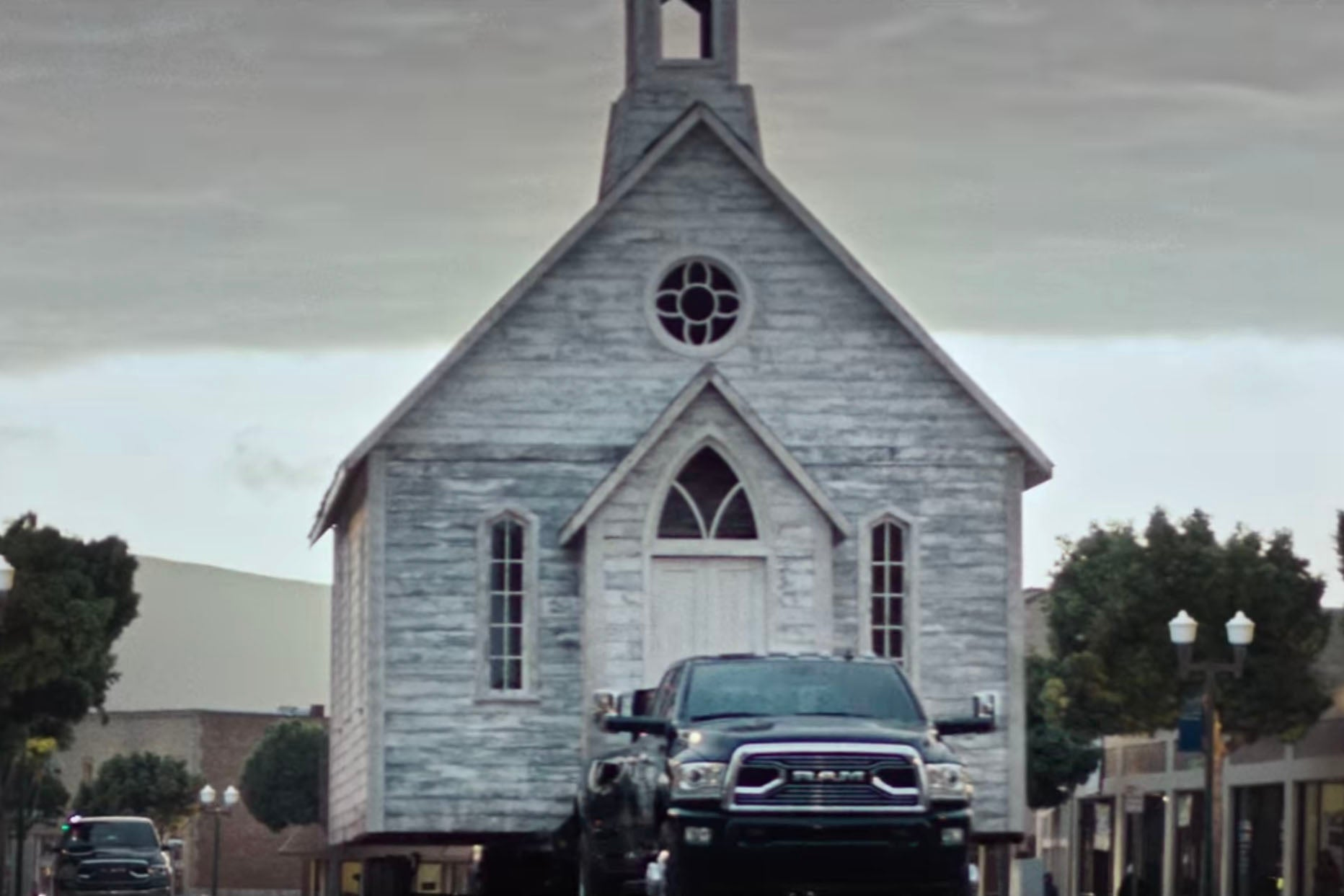 A Ram truck pulling a church.