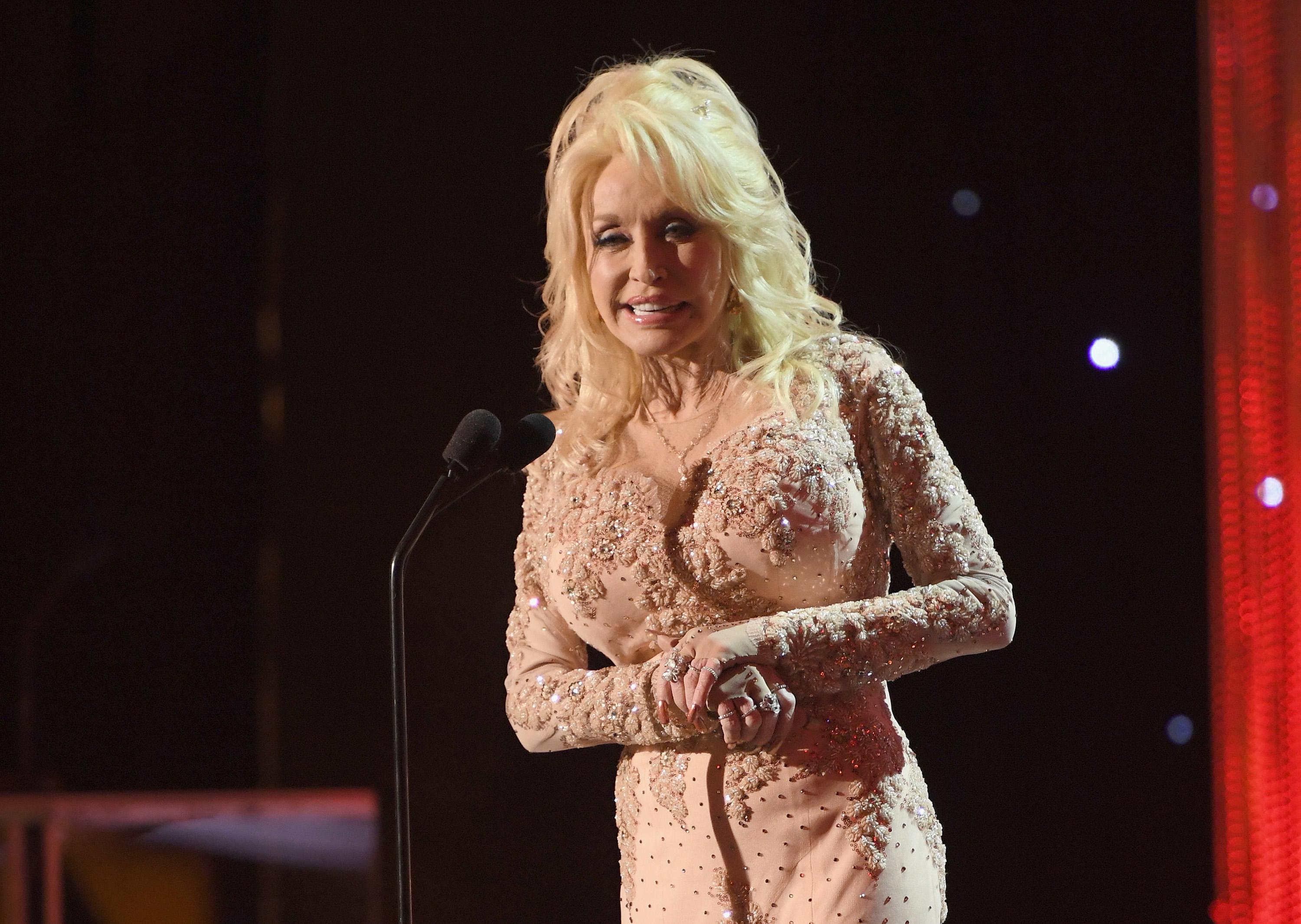 LOS ANGELES, CA - JANUARY 29:  Singer Dolly Parton speaks onstage during The 23rd Annual Screen Actors Guild Awards at The Shrine Auditorium on January 29, 2017 in Los Angeles, California. 26592_009  (Photo by Dimitrios Kambouris/Getty Images for TNT)