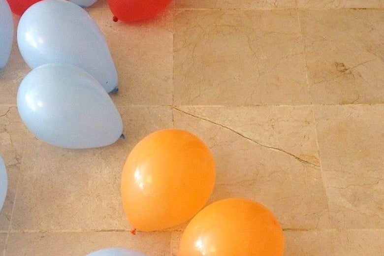Balloons on the floor at the house.