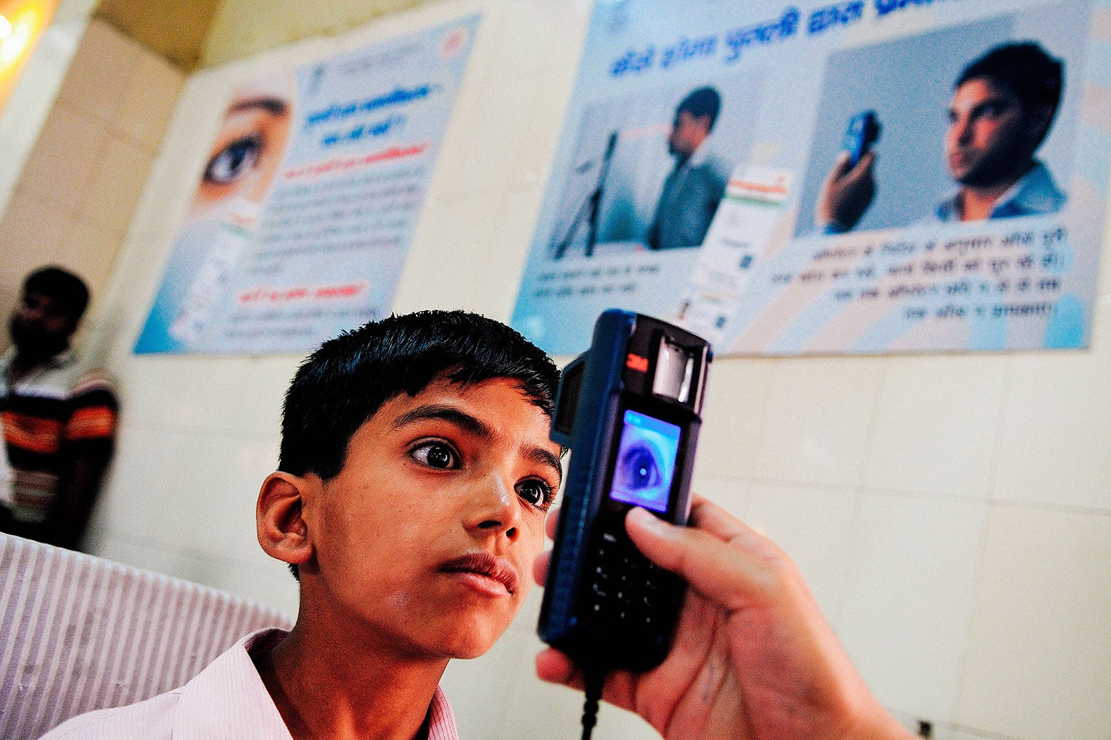 A boy has his iris scanned for the Aadhaar identity system on April 12, 2013 in New Delhi.