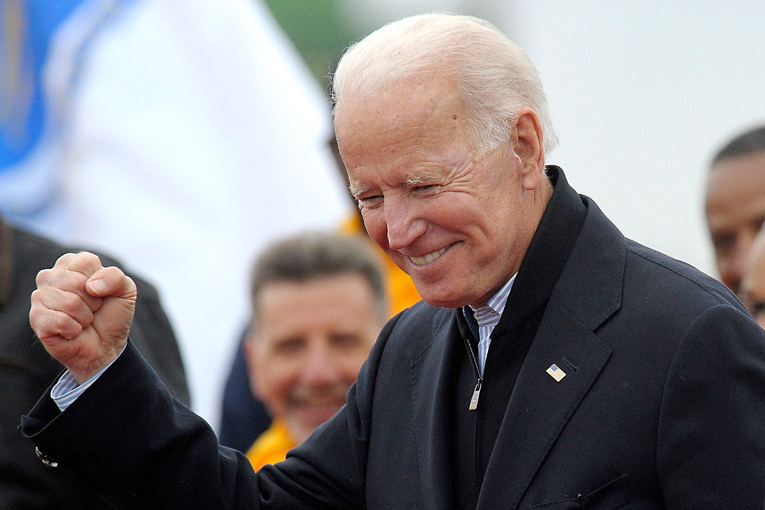 Joe Biden leaves a rally organized by UFCW Union members at the Stop and Shop in Dorchester, Massachusetts, on Friday.