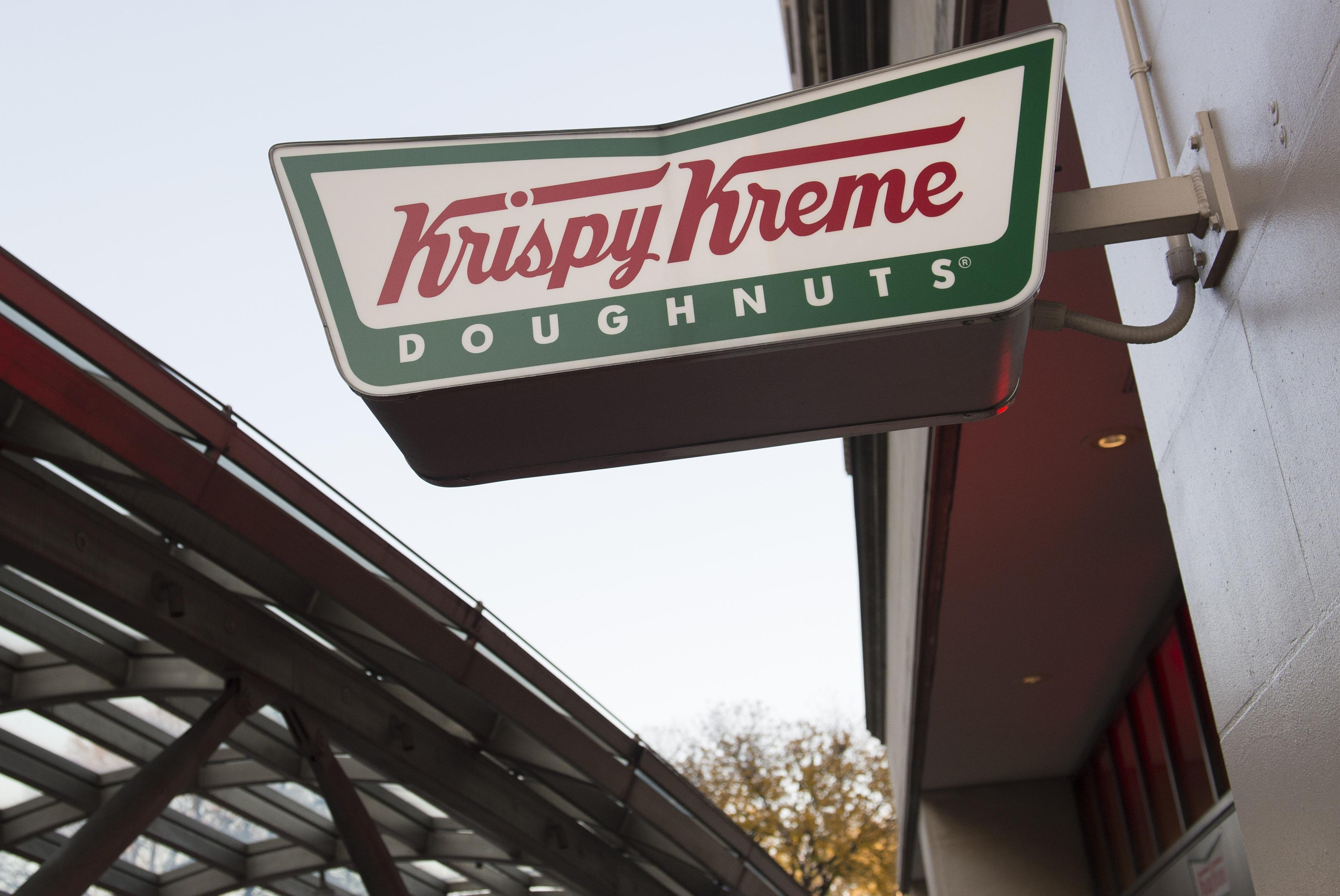 A sign for Krispy Kreme doughnuts